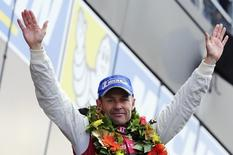 Audi R18 E-Tron Quattro Number 2 driver Tom Kristensen of Denmark celebrates on the podium after winning the Le Mans 24-hour sportscar race in Le Mans, central France June 23, 2013. REUTERS/Stephane Mahe