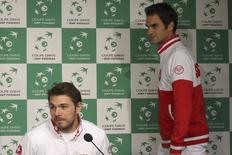 Switzerland's Davis Cup team players Stanislas Wawrinka (L) and Roger Federer attend a news conference at the Pierre Mauroy stadium in Villeneuve d'Ascq, northern France, November 18, 2014. REUTERS/Pascal Rossignol