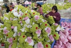 Employees make stuffed toys which they are exporting to Europe and America, at a toy factory in Lianyungang, Jiangsu province October 8, 2014.  REUTERS/China Daily