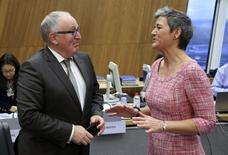 European Commission First Vice-President Frans Timmermans listens to European Competition Commissioner Margrethe Vestager (R) during the first official meeting of the EU's executive body at the EU Commission headquarters in Brussels November 5, 2014.  REUTERS/Francois Lenoir