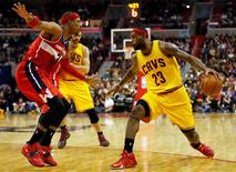 Nov 21, 2014; Washington, DC, USA; Cleveland Cavaliers forward LeBron James (23) dribbles the ball as Washington Wizards forward Paul Pierce (34) defends in the fourth quarter at Verizon Center. The Wizards won 91-78. Mandatory Credit: Geoff Burke-USA TODAY Sports