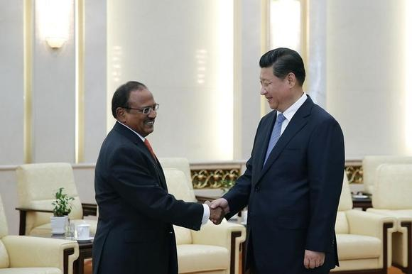 Chinese President Xi Jinping (R) shakes hands with India's National Security Adviser Ajit Doval at the Great Hall of the People in Beijing September 9, 2014.  REUTERS/Lintao Zhang/Pool