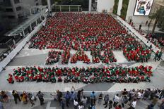 Students gather to break the Guinness World Record for the largest gathering of Christmas elves, outside a shopping mall in central Bangkok, November 25, 2014. REUTERS/Chaiwat Subprasom