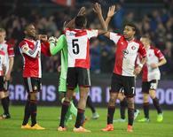 Jogadores do Feyenoord comemoram vitória sobre o Sevilla pela Liga Europa em Roterdã. 27/11/2014 REUTERS/Michael Kooren