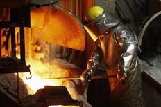 A worker looks on while pouring melted copper into a furnace at the KGHM Copper and Precious Metals smelter and processing plant in Glogow May 10, 2013. REUTERS/Peter Andrews