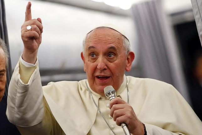 Pope Francis gestures as he speaks with journalists on the flight back from Istanbul to Rome, November 30, 2014. REUTERS/Tony Gentile