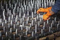 An employee prepares FIAMM batteries, in this photo illustration taken at the battery maker's factory in Avezzano, near L'Aquila, November 28, 2014.   REUTERS/Alessandro Bianchi
