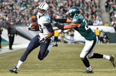 Nov 23, 2014; Philadelphia, PA, USA; Tennessee Titans wide receiver Justin Hunter (15) gets past Philadelphia Eagles cornerback Bradley Fletcher (24) for a touchdown at Lincoln Financial Field. Mandatory Credit: Derik Hamilton-USA TODAY Sports