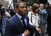 Former Baltimore Ravens NFL running back Ray Rice and his wife Janay at a New York City office building November 5, 2014. REUTERS/Mike Segar