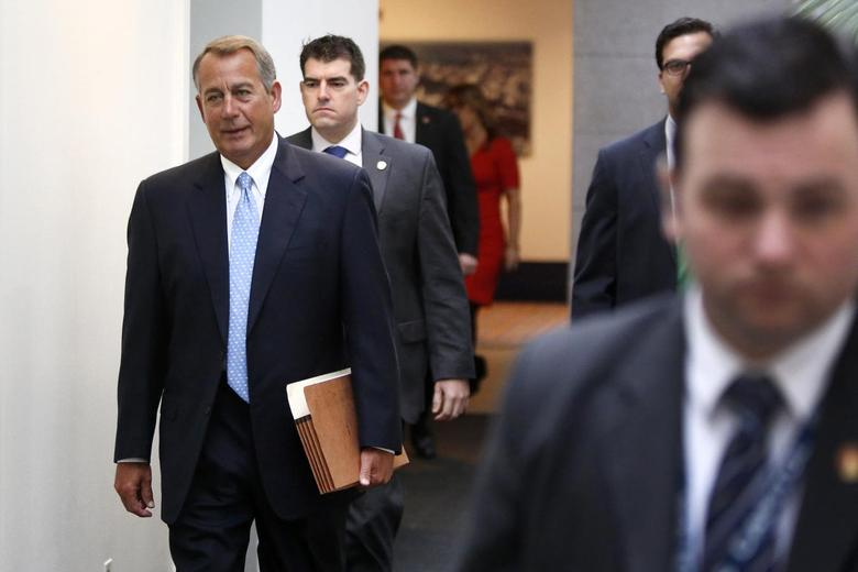 U.S. House Speaker John Boehner (R-OH) (L) arrives for a House Republican caucus meeting at the U.S. Capitol in Washington December 2, 2014. REUTERS/Jonathan Ernst