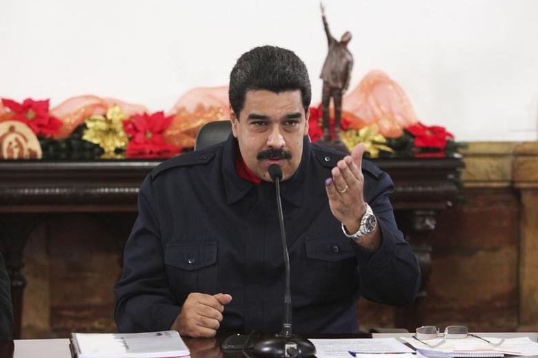 Venezuela's President Nicolas Maduro speaks during a meeting with ministers at Miraflores Palace in Caracas in this handout photo provided by Miraflores Palace November 25, 2014. REUTERS/Miraflores Palace/Handout