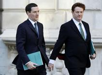 Britain's Chancellor of the Exchequer George Osborne (L) and Chief Secretary to the Treasury Danny Alexander leave the Treasury to present the Autumn Statement to Parliament in London December 3, 2014. REUTERS/Alastair Grant/pool