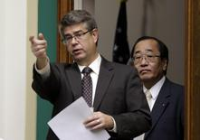 "Rep. Lee Terry (R-NE) (L), the chair of the U.S. House Energy and Commerce Subcommittee hearing on ""Takata Airbag Ruptures and Recalls"", escorts Hiroshi Shimizu (R), Takata Senior Vice President for global quality assurance, in Washington December 3, 2014.   REUTERS/Gary Cameron"