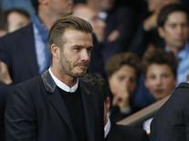 Former soccer player David Beckham arrive to attend the Champions League Group F soccer match between Paris St Germain and Barcelona at the Parc des Princes Stadium in Paris, September 30, 2014.    REUTERS/Benoit Tessier