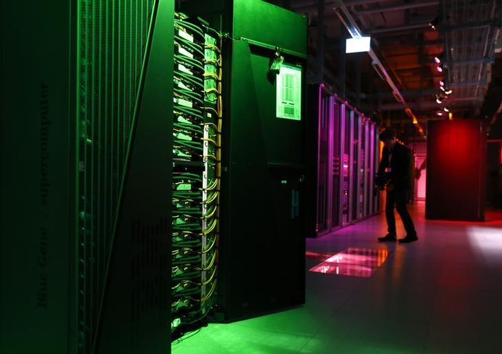 A member of the media films the room with the IBM Blue Gene Q Supercomputer on the launch day for the HBP at the Swiss Federal Institute of Technology (EPFL) in Ecublens, near Lausanne  October 7, 2013. REUTERS/Denis Balibouse