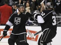 Los Angeles Kings' Alec Martinez (L) celebrates with goaltender Jonathan Quick after they defeated the Vancouver Canucks in a penalty shootout during their NHL game in Los Angeles, California, January 28, 2013. REUTERS/Lucy Nicholson