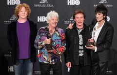 Ronnie Wood (R), Kenny Jones (2nd R) and Ian McLagan (3rd R) pose with their awards after being inducted into the Rock n' Roll Hall of Fame in Cleveland, Ohio April 14, 2012. On the left is Mick Hucknall who was performing as a stand-in for Small Faces member Rod Stewart. REUTERS/Aaron Josefczyk
