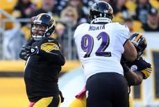 Pittsburgh Steelers quarterback Ben Roethlisberger (7) throws a pass under pressure from Baltimore Ravens nose tackle Haloti Ngata (92) during the first quarter at Heinz Field. Oct 20, 2013; Pittsburgh, PA, USA; Jason Bridge-USA TODAY Sports