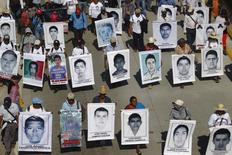 Relatives hold pictures of missing students from the Ayotzinapa Teacher Training College Raul Isidro Burgos, during a demonstration demanding the government find them, on the 40th anniversary of the death of Mexican revolutionary Lucio Cabanas, in Chilpancingo, Guerrero December 2, 2014.  REUTERS/Jorge Dan Lopez