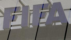 The logo of soccer's international governing body FIFA is seen on its headquarters in Zurich October 3, 2013. REUTERS/Arnd Wiegmann/Files