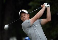 Luke Donald tees off the 10th hole during the second round of the RBC Canadian Open at Royal Montreal GC - Blue Course. Jul 25, 2014; Ile Bizard, Quebec, CAN;: Eric Bolte-USA TODAY Sports