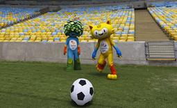 The unnamed mascots of the Rio 2016 Olympic (R) and Paralympic Games are pictured during a visit at the Maracana Stadium in Rio de Janeiro December 4, 2014. REUTERS/Ricardo Moraes