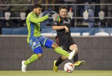 Nov 30, 2014; Seattle, WA, USA; Los Angeles Galaxy forward Robbie Keane (7) puts a pass in front of Seattle Sounders FC defender DeAndre Yedlin (17) during the first half of the Western Conference Championship at CenturyLink Field. Mandatory Credit: Joe Nicholson-USA TODAY Sports - RTR4G6NF