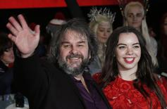 "Director Peter Jackson poses with his daughter Katie Jackson (R) as they arrive for the world film premiere of ""The Hobbit: The Battle of the Five Armies"" at Leicester Square in central London, December 1, 2014. REUTERS/Suzanne Plunkett"