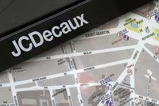 The logo of outdoor advertising group JCDecaux is seen near an information panel with a neighbourhood map in Paris March 7, 2014.   REUTERS/Jacky Naegelen