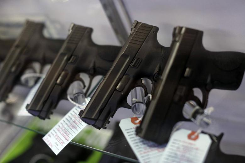 Handguns are seen for sale in a display case at Metro Shooting Supplies in Bridgeton, Missouri, November 13, 2014. REUTERS/Jim Young