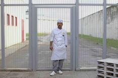 Prison baker Marco Frizziarello, 38, is pictured during a break outside the kitchens of the Pasticceria Giotto in Padua's Due Palazzi prison December 2, 2014. REUTERS/Alessandro Bianchi