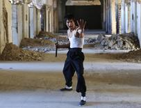 Abbas Alizada, who calls himself the Afghan Bruce Lee, poses for the media in Kabul December 9, 2014. REUTERS/Mohammad Ismail