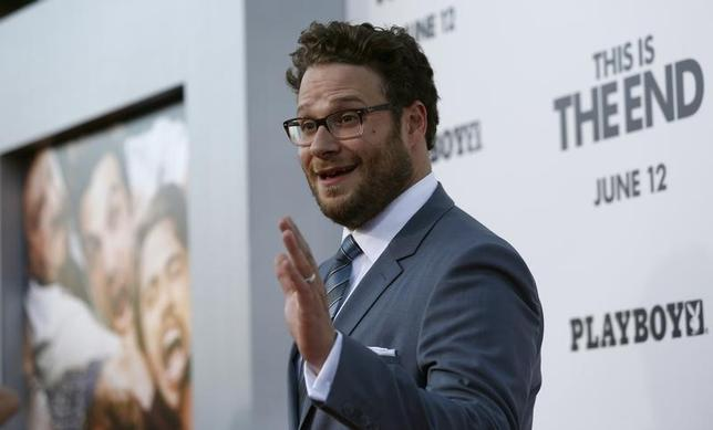 Director, writer and cast member Seth Rogen waves at the premiere of ''This Is the End'' at the Regency Village Theatre in Los Angeles, California June 3, 2013. REUTERS/Mario Anzuoni