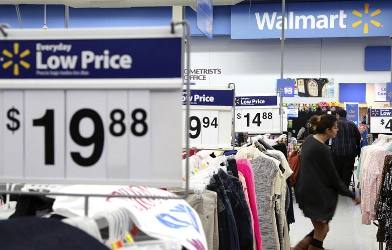 A woman shops at Walmart as the store prepares for Black Friday in Los Angeles, California November 24, 2014.  REUTERS/Jonathan Alcorn