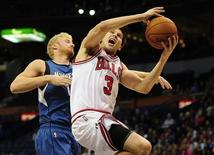 Oct 24, 2014; St. Louis, MO, USA; Chicago Bulls forward Doug McDermott (3) shoots the ball as Minnesota Timberwolves forward Chase Budinger (10) defends during the first quarter at Scottrade Center. Mandatory Credit: Jeff Curry-USA TODAY Sports - RTR4BJ1S