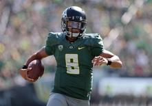 Sep 13, 2014; Eugene, OR, USA; Oregon Ducks quarterback Marcus Mariota (8) runs the ball for a touchdown in the second quarter against the Wyoming Cowboys at Autzen Stadium. Mandatory Credit: Scott Olmos-USA TODAY Sports - RTR463ZW
