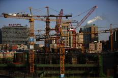 Cranes are seen at a construction site in Beijing December 12, 2014.  REUTERS/Kim Kyung-Hoon