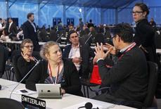 Delegates talk during a plenary session of the U.N. Climate Change Conference COP 20 in Lima December 13, 2014.  REUTERS/Enrique Castro-Mendivil