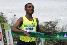 Kenenisa Bekele of Ethiopia crosses the finish line to win the 38th Paris Marathon  in Paris April 6, 2014.   REUTERS/Gonzalo Fuentes