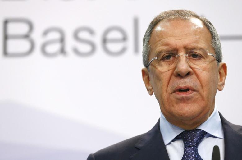 Russia's Foreign Minister Sergei Lavrov speaks to media in a news conference during a meeting of foreign ministers from the Organization for Security and Cooperation in Europe (OSCE) in Basel December 5, 2014.  REUTERS/Arnd Wiegmann
