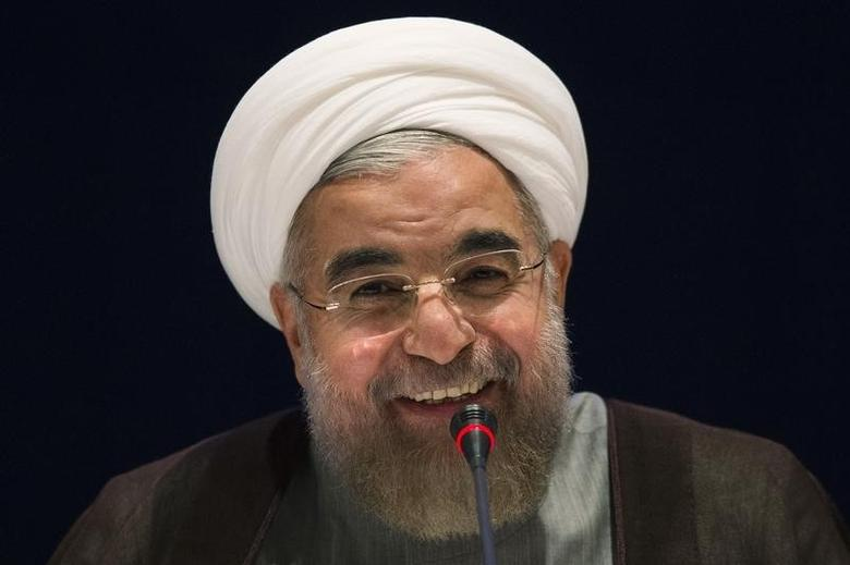 Iran's President Hassan Rouhani smiles while replying to a question during a news conference on the sidelines of the 69th United Nations General Assembly at United Nations Headquarters in New York September 26, 2014.REUTERS/Adrees Latif