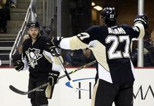 Pittsburgh Penguins right wing Bryan Rust (36) reacts with right wing Craig Adams (27) after Rust scored his first NHL goal against the Tampa Bay Lightning during the second period at the CONSOL Energy Center. Mandatory Credit: Charles LeClaire-USA TODAY Sports