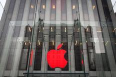 The Apple logo is illuminated in red at the Apple Store on 5th Avenue to mark World AIDS Day, in the Manhattan borough of New York December 1, 2014.  REUTERS/Carlo Allegri