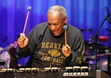 "Comedian Bill Cosby plays the vibraphone during ""Three Score"", at the Berklee College of Music's 60th anniversary concert, in Boston, Massachusetts in this January 28, 2006 file photo. REUTERS/Rick Friedman/Files"