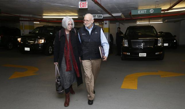 Alan and Judy Gross walk through a parking garage after arriving for  a news conference in Washington December 17, 2014. Cuba released Alan Gross after five years in prison in a reported prisoner exchange with Havana. REUTERS/Kevin Lamarque