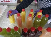 Bottled juice are arranged at a fruit stall in a traditional market in Taipei December 16, 2014. REUTERS/Pichi Chuang