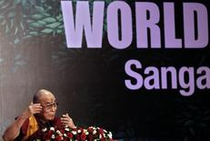 Exiled Tibetan spiritual leader, the Dalai Lama, speaks during the World Hindu Congress 2014 conference in New Delhi November 21, 2014. REUTERS/Anindito Mukherjee
