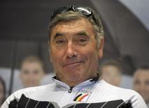 Belgian five-time Tour de France and Giro d'Italia winner Eddy Merckx smiles as he prepares to cycle to London for the opening ceremony of the Olympic Games, at the Belgium Olympics Committee headquarters in Brussels in this July 25, 2012 file photo. REUTERS/Laurent Dubrule/Files