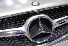 A Mercedes-Benz logo is seen on a car displayed on media day at the Paris Mondial de l'Automobile, October 2, 2014.  REUTERS/Jacky Naegelen