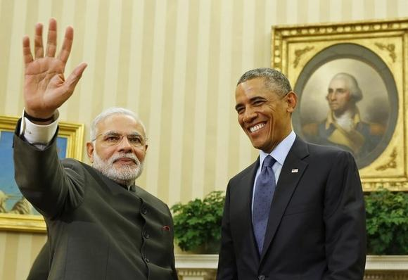 U.S. President Barack Obama smiles as he hosts a meeting with Prime Minister Narendra Modi in the Oval Office of the White House in Washington September 30, 2014. REUTERS/Larry Downing/Files